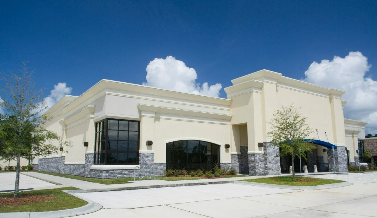 beige stucco with gray brick retail store